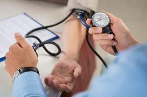 Doctor Measures Pressure In The Patient