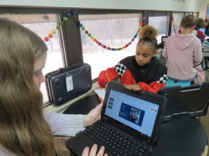 students use chrome books to research prominent African Americans