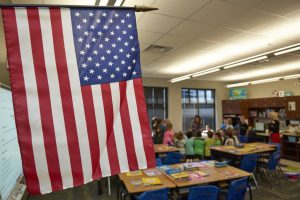 classroom with american flag in foreground