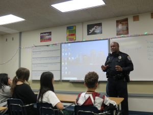 Officer speaks to 7th graders