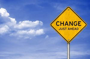 """Yellow Traffic Sign proclaiming """"Change Just Ahead"""""""