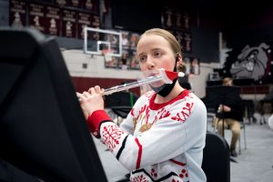 A memorial high school student plays the flute
