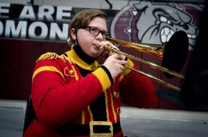 A student plays the trombone