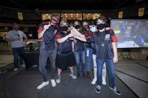 The-League-of-Legends-team-celebrates-after-winning-the-Oklahoma-State-eSport-competition-with-headcoach-Kate-Swearingen-