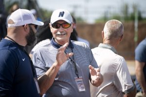 Edmond North Athletic Director Tom Snider talks to another coach during a recent athletic event