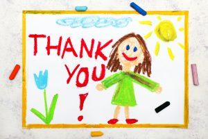 child's crayon drawning of Thank you sign