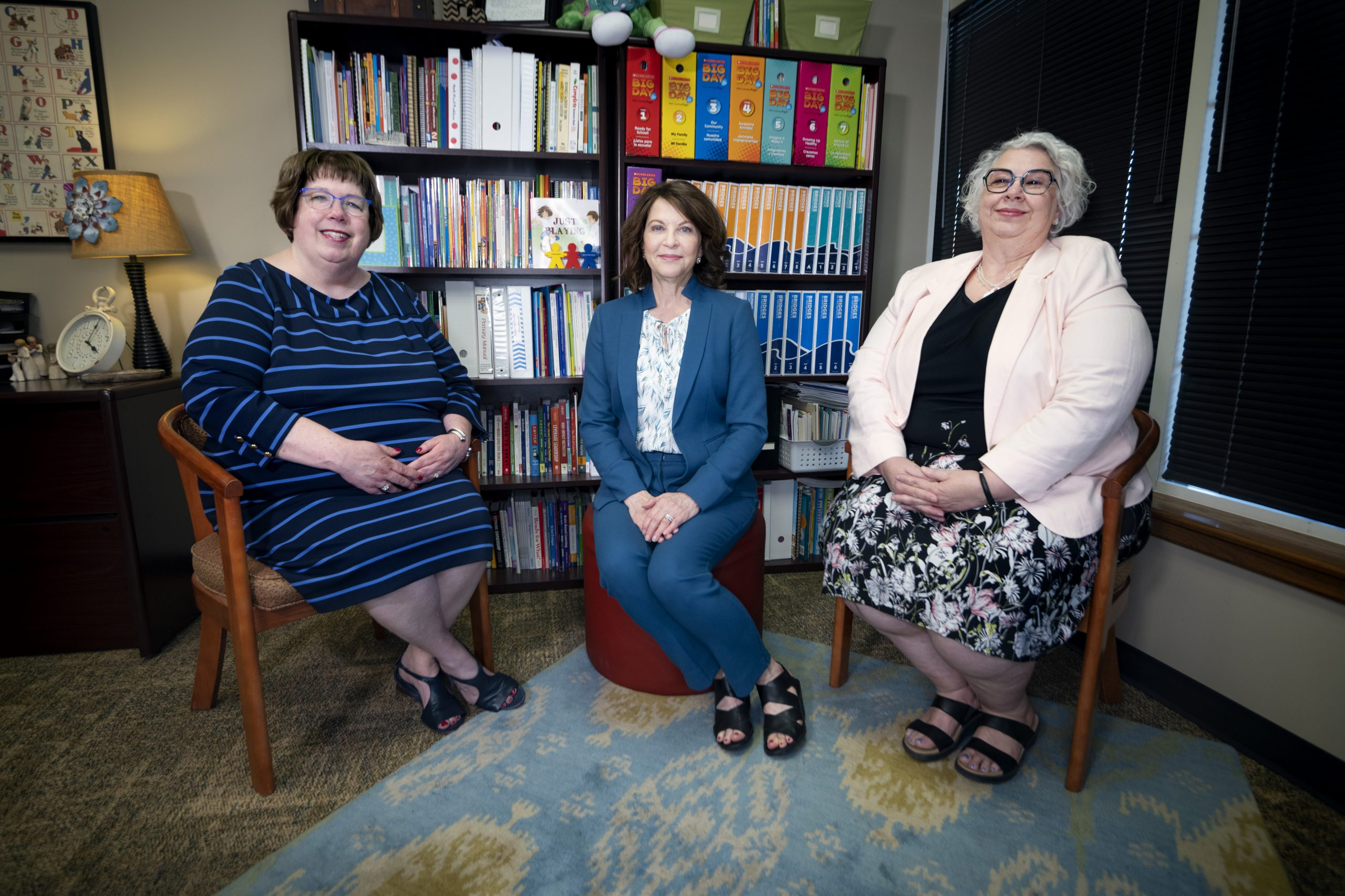 Retiring principals Cathie Bugg, Jessele Miller and Penny Gooch sit in an office together