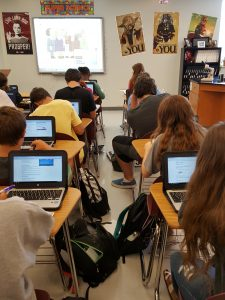 students learning in a classroom with Chromebooks